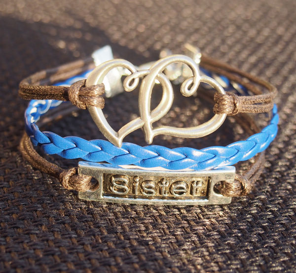 heart-to-heart-sister-charm-bracelet-brown-with-blue-color