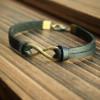 Infinity-bracelet-bronze-black-leather-charms