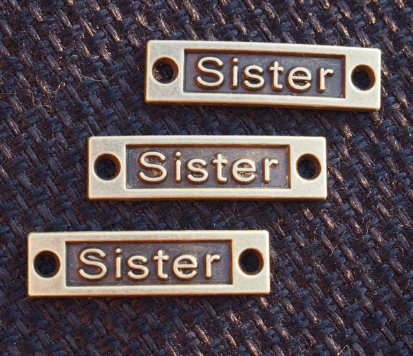 Sister-bronze-pendants-wholesale